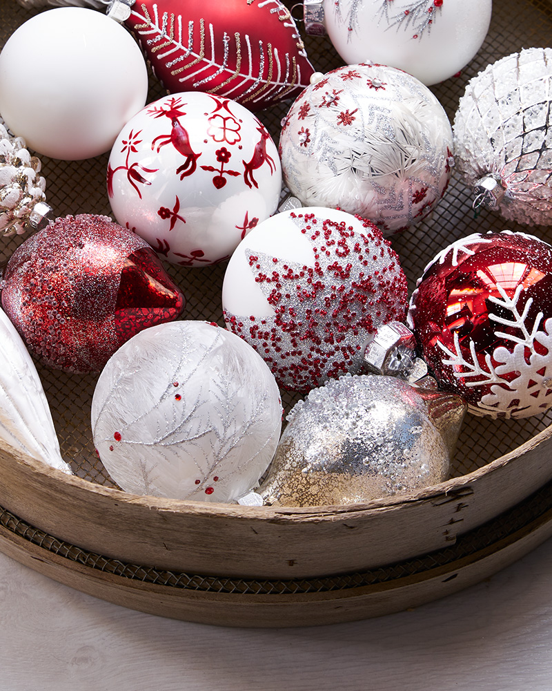 close up of red and white christmas ornaments