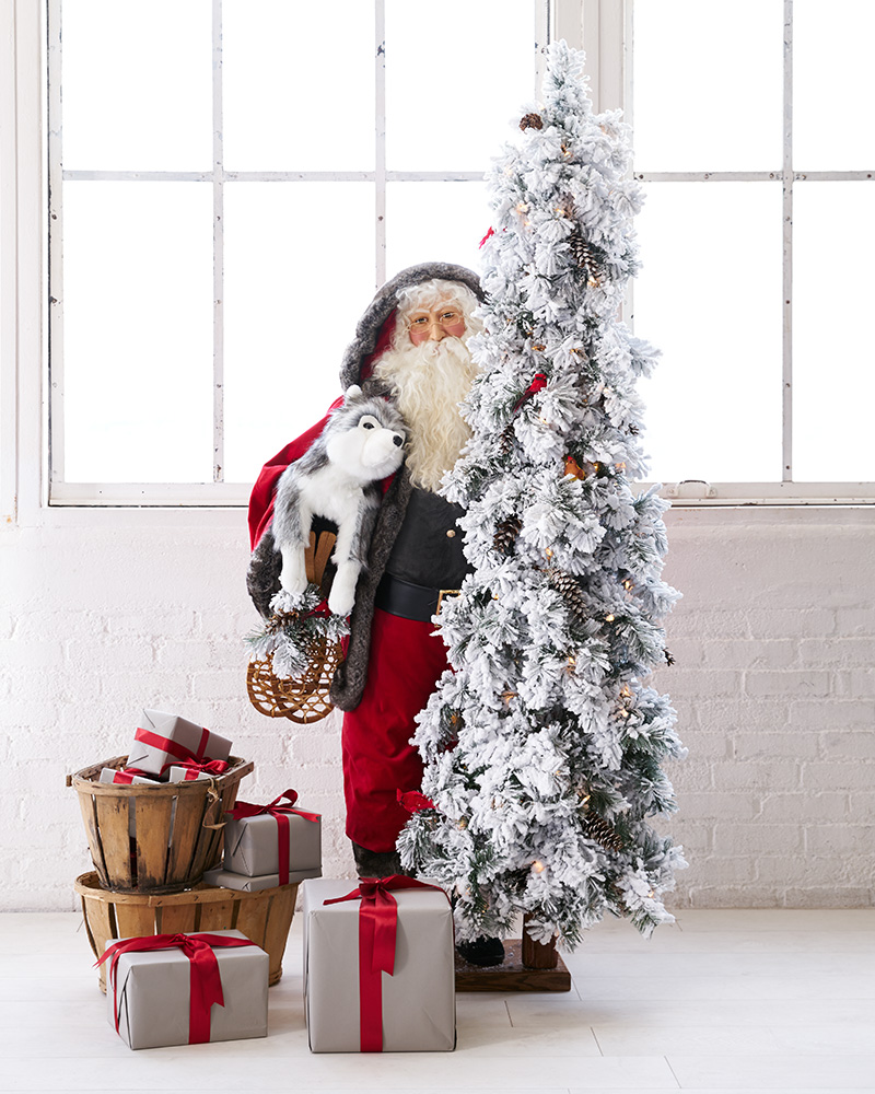 Life-size Santa figure with pet and tree