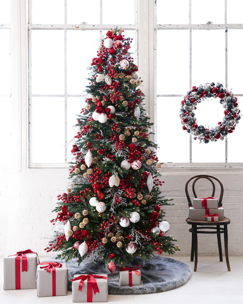 full shot of christmas tree and wreath set up in red and white theme