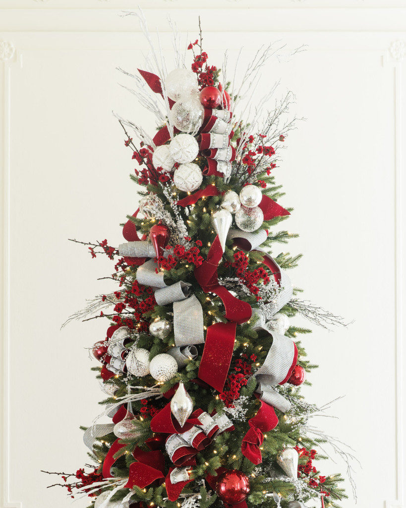 balsam hill silverado slim decorated with red, white, and silver balls, picks, and ribbons