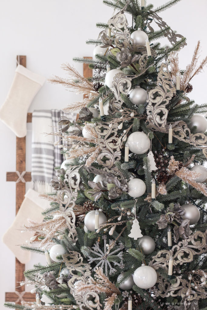 Christmas tree decorated with pewter, pearl, and white ornaments