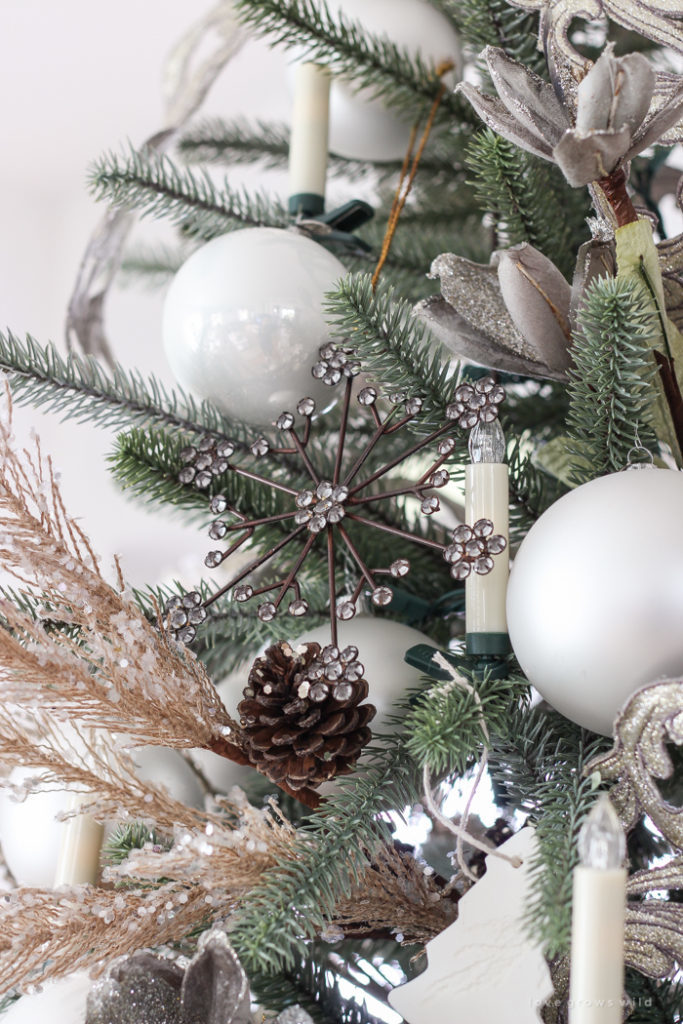 snowflake, pinecone, christmas balls, candles on tree