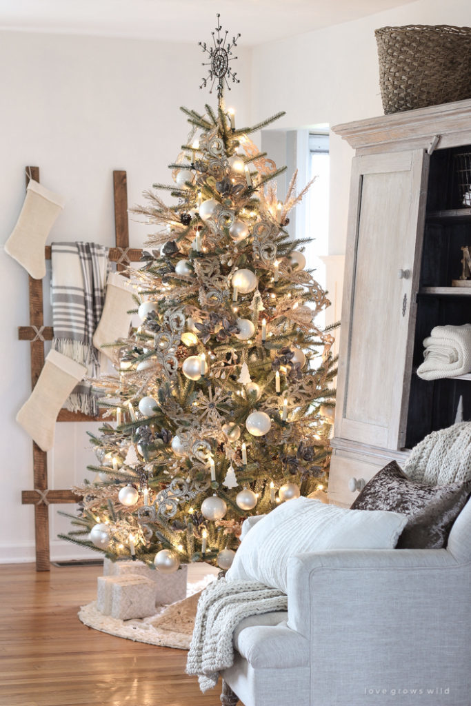 full shot of decorated pre-lit artificial christmas tree