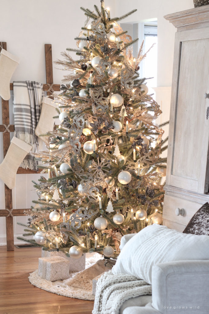 Pre-lit artificial Christmas tree decorated with winter theme