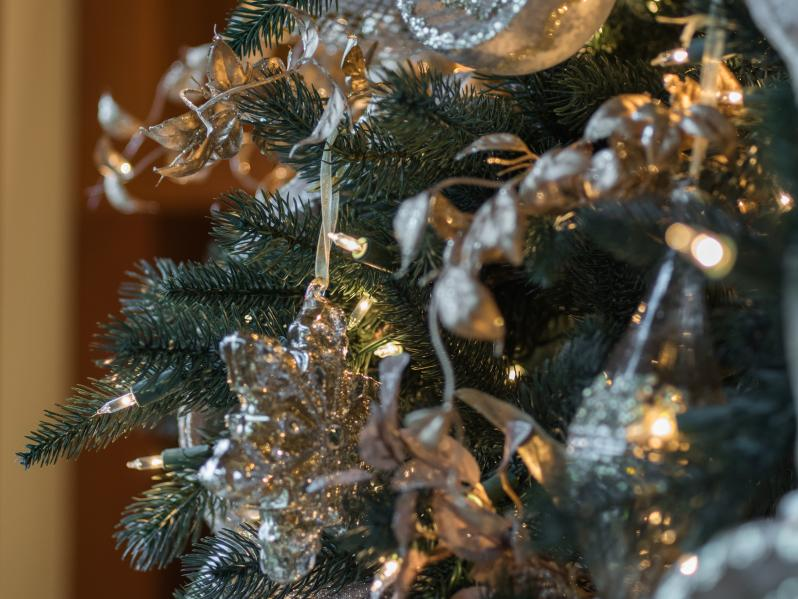 Close up of silver and gold tree ornaments