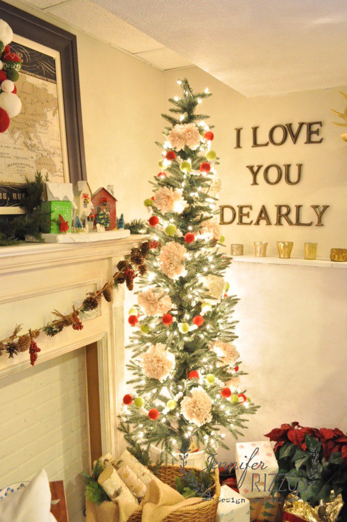 pre-lit artificial christmas tree with wool garland and pom-pom decor