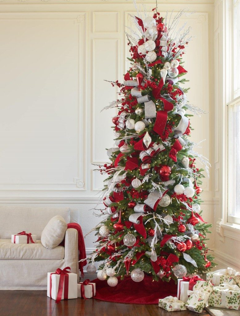 full shot of artificial Christmas tree decorated with red, white, and silver ornaments
