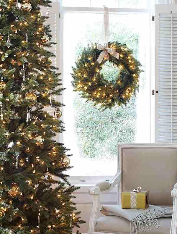 Balsam Hill Silverado Slim Simple and Elegant Christmas Tree and Wreath by living room window