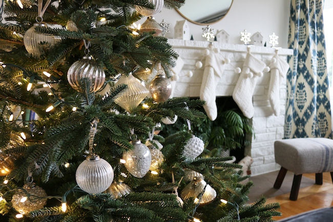 Close up of French Country glass ornaments on tree