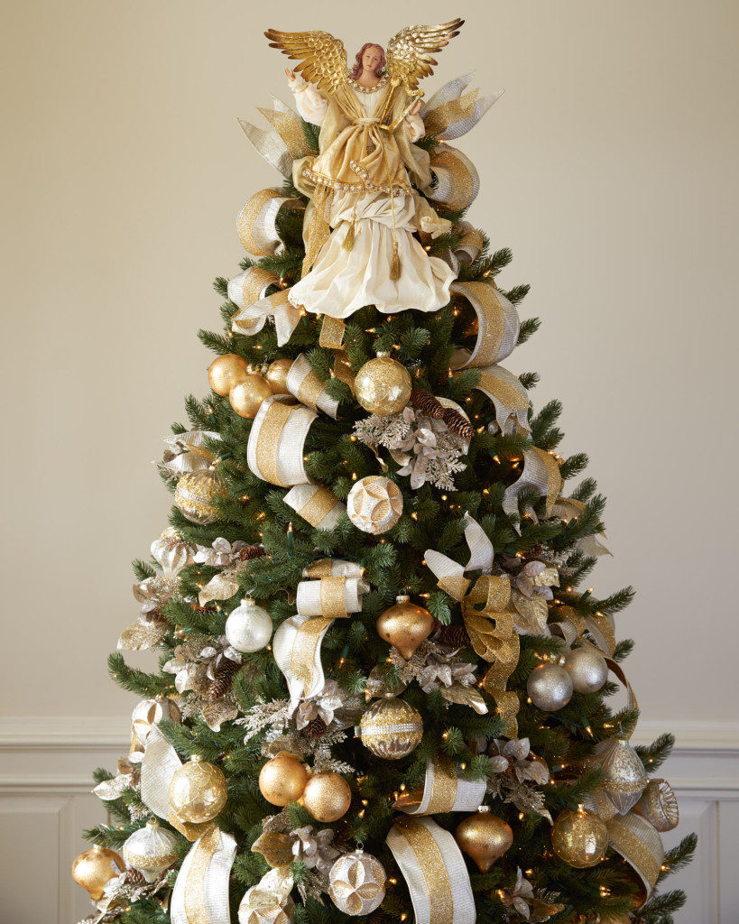 Vermont White Spruce decorated with silver and gold ornaments and angel tree topper