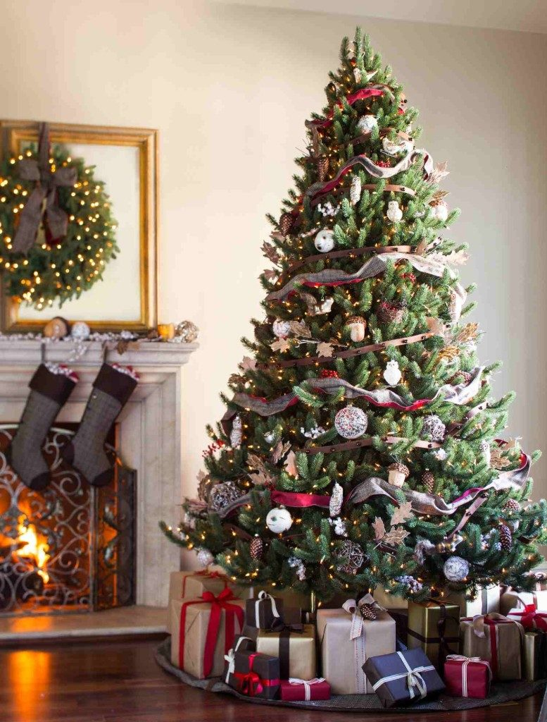 Full shot of artificial Christmas tree with woodland-themed ornaments and decorations
