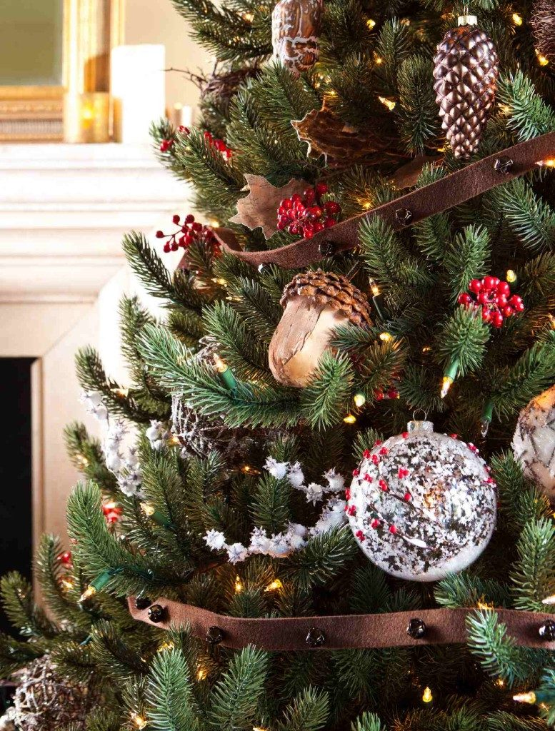 Woodland-themed ornaments and decorations on artificial Christmas tree