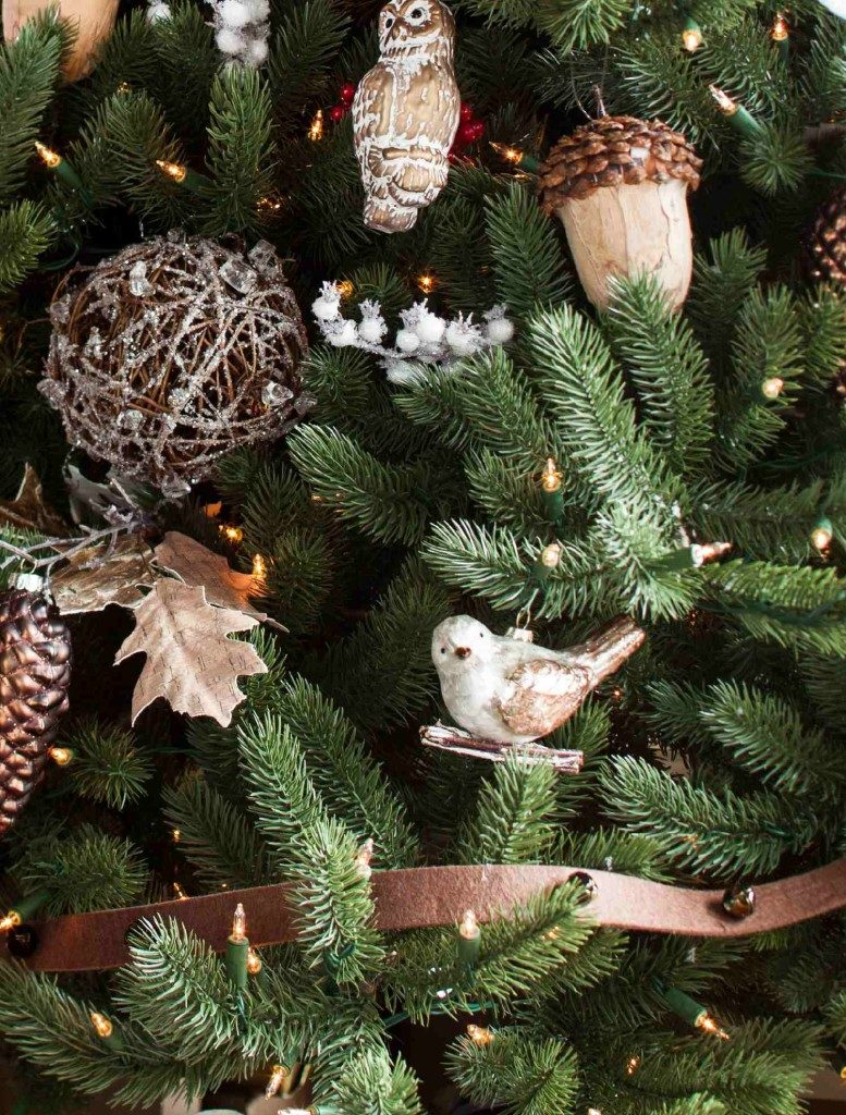 Close up of woodland-themed ornaments and decorations on artificial Christmas tree