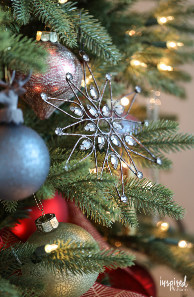 Close up of Christmas tree snowflake and ball ornaments