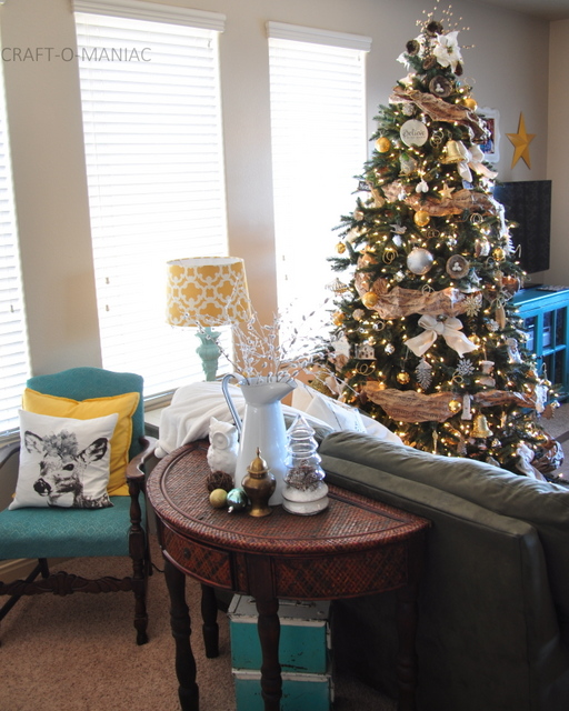 Living room with decorated artificial Christmas tree