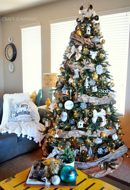 Artificial Christmas tree decorated with silver and gold