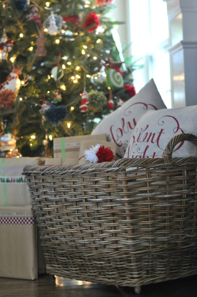 Christmas-themed pillows inside a basket