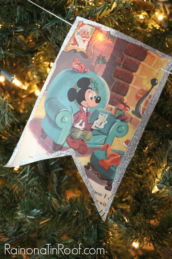 Closeup shot of a Mickey Mouse book page garland hanging from a Christmas tree