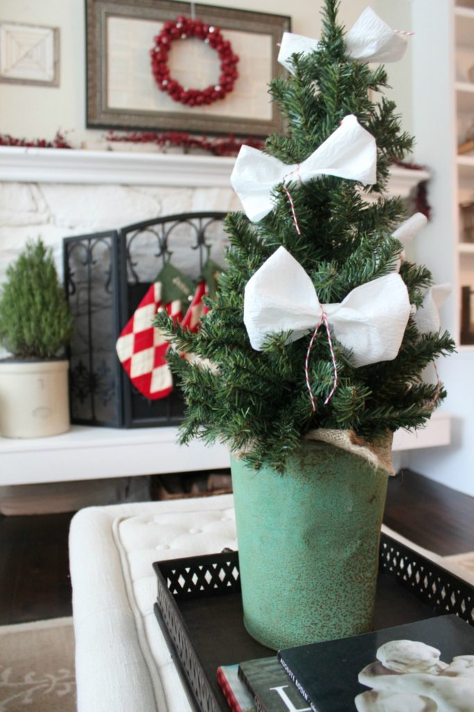 Small potted tree with white ribbons