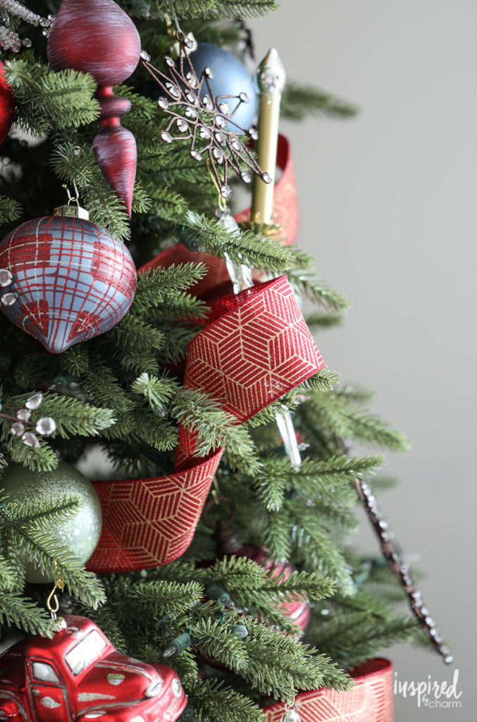 Close up of Christmas tree with ornaments and ribbon