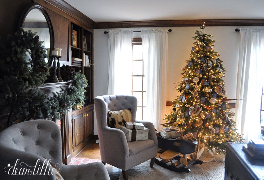 A living room with a lit-up Christmas tree by the window