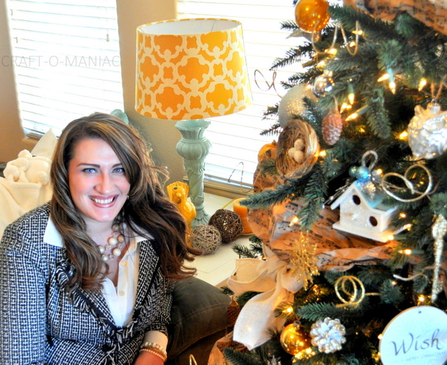Woman beside decorated Christmas tree