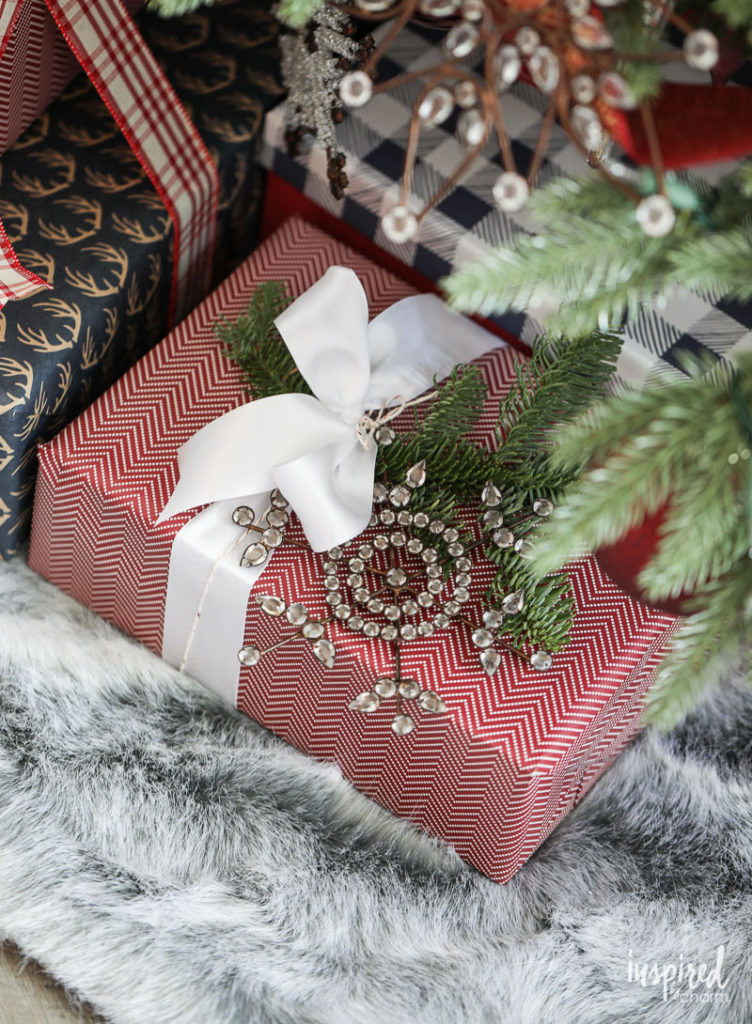 Wrapped gift under tree with ornament accent
