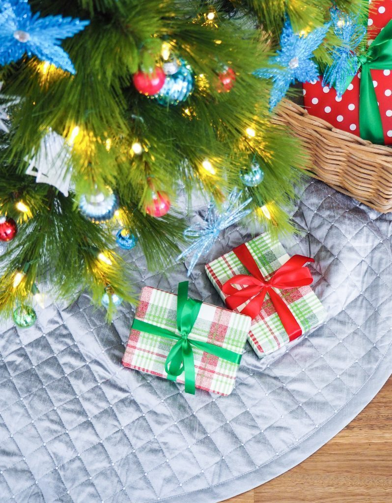 pre-lit pine tree with quilted tree skirt
