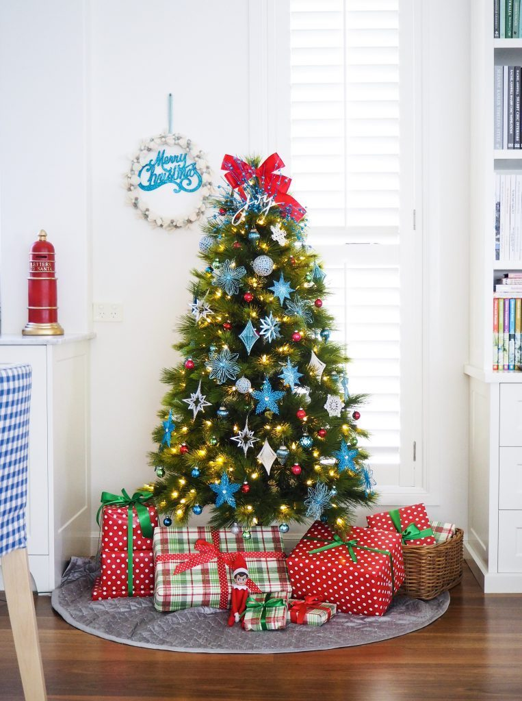 pine tree decorated with red and blue ornaments