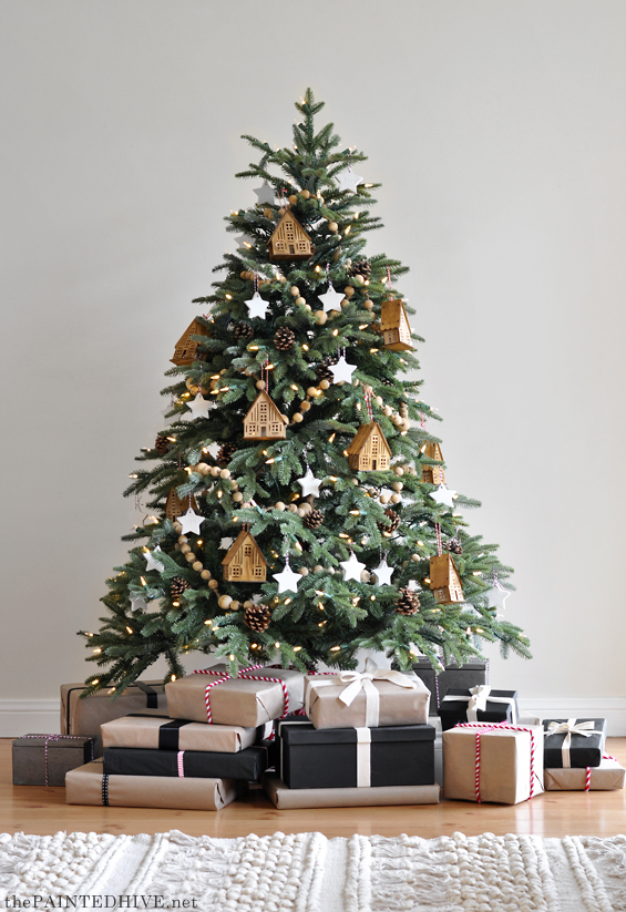 Natural and neutral Christmas tree with Christmas gifts wrapped in kraft and black papers