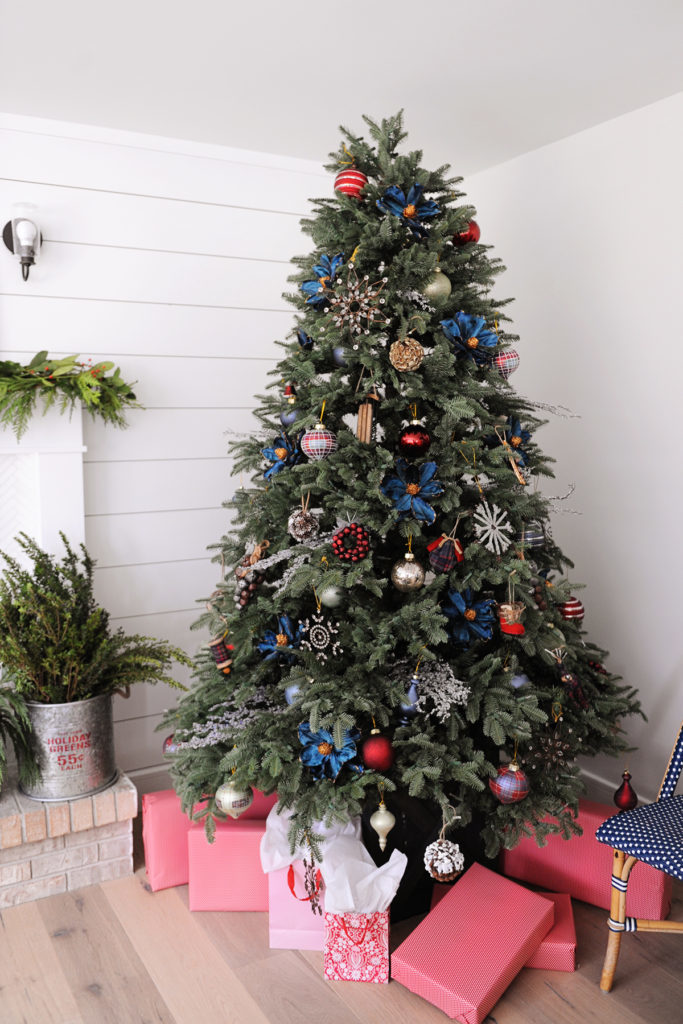 Artificial Christmas tree decorated with vintage farmhouse theme