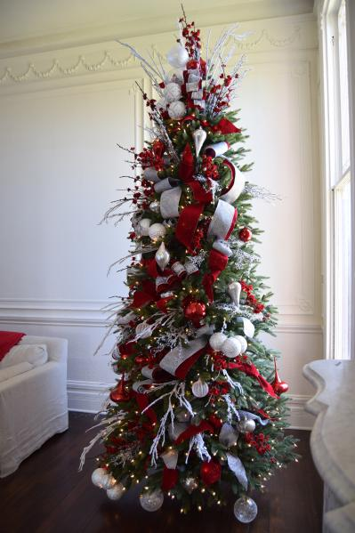 full shot of red, white, and silver christmas tree