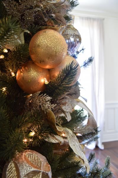 silver and gold ornaments on tree