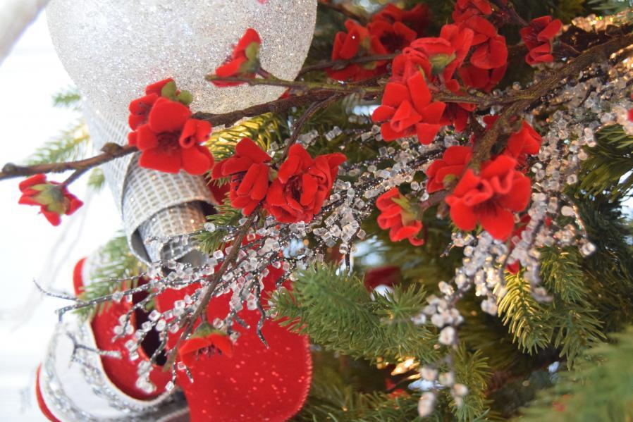 close up of red, white, and silver tree decorations