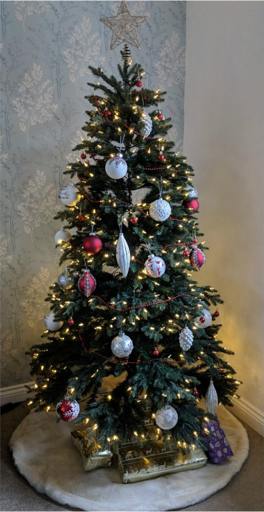 Pre-lit Christmas tree with red and white ornaments