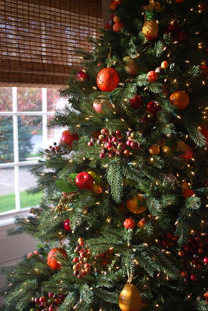 Artificial Christmas tree decorated with assorted fruits theme