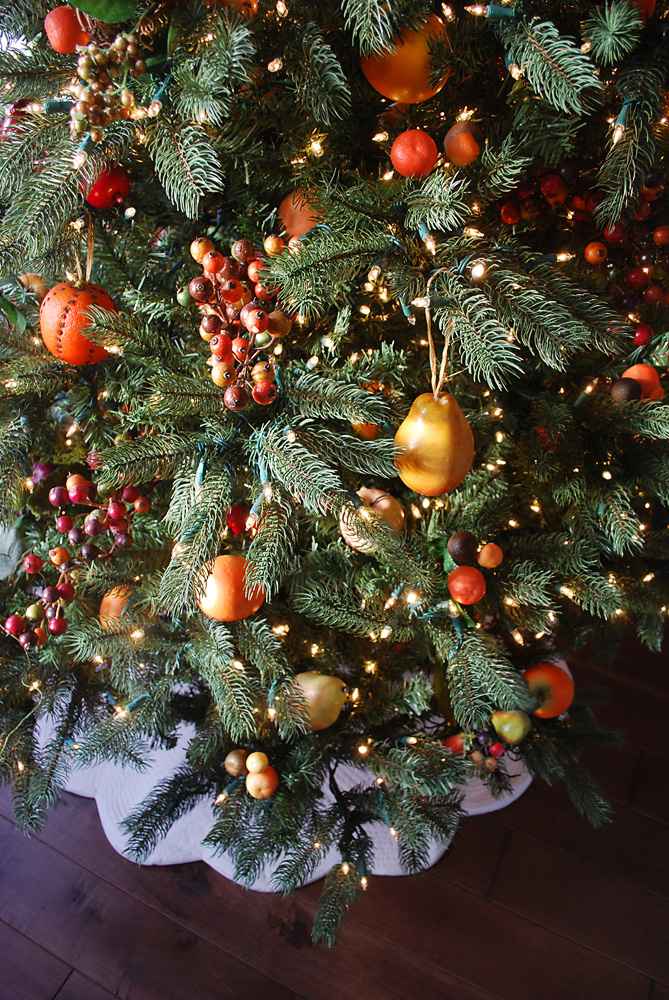 Artificial Christmas tree with assorted fruit decorations