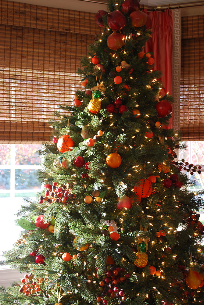 Artificial Christmas tree decorated with assorted fruit ornaments