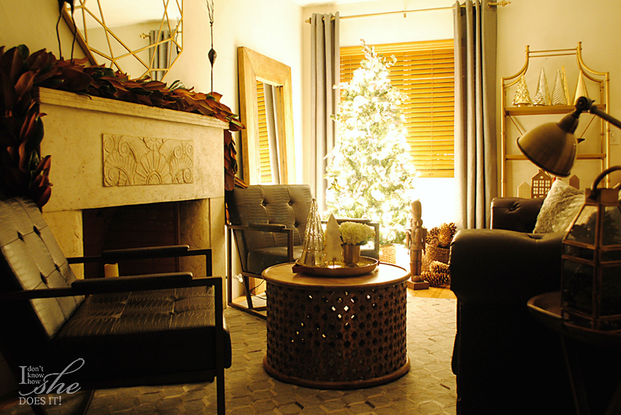 Wide shot of a room decorated with a lit-up Christmas tree