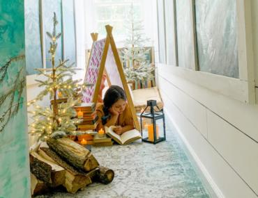 Girl inside her indoor camping wonderland