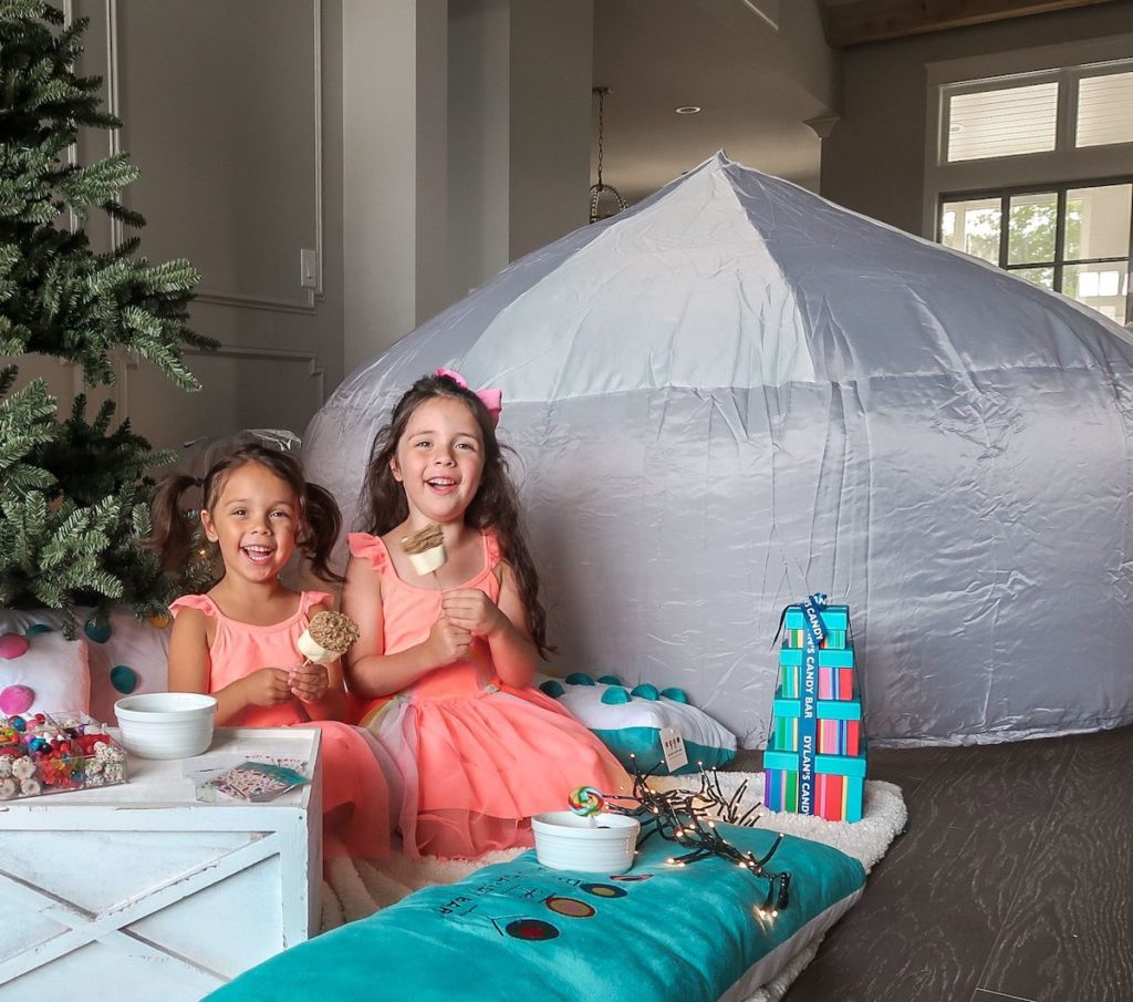 Balsam Hill indoor camping with two girls eating smores