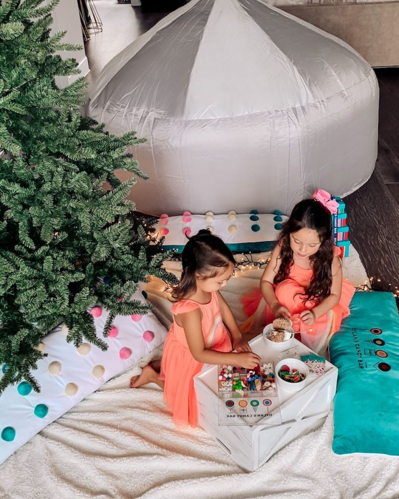 Balsam Hill indoor camping with two kids enjoying candies
