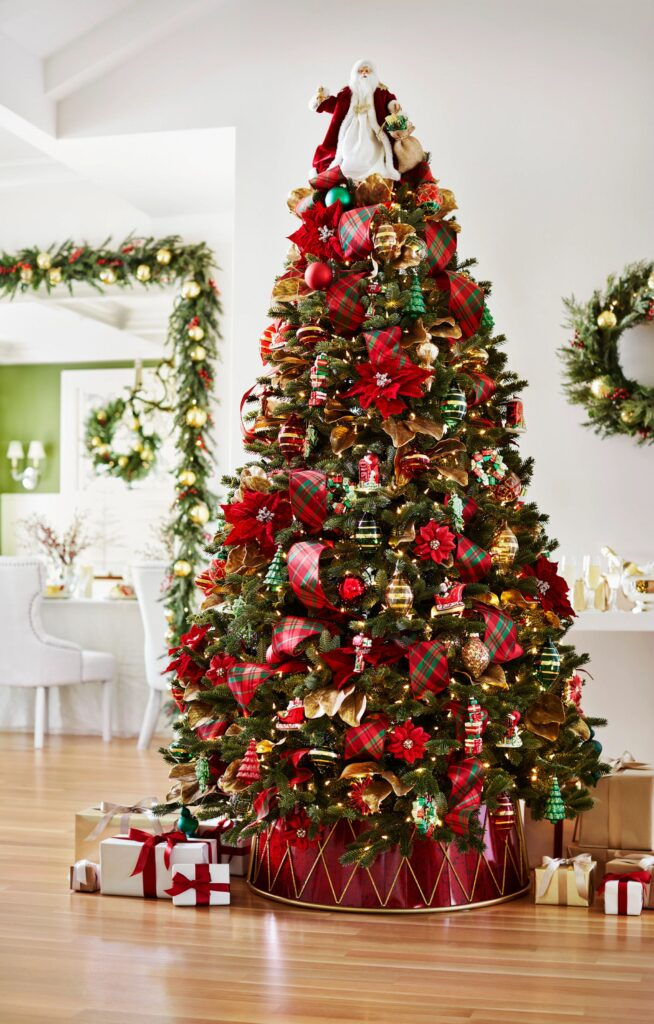 Red and green Christmas tree with Santa tree topper