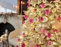 pink and blush ornaments on frosted christmas tree