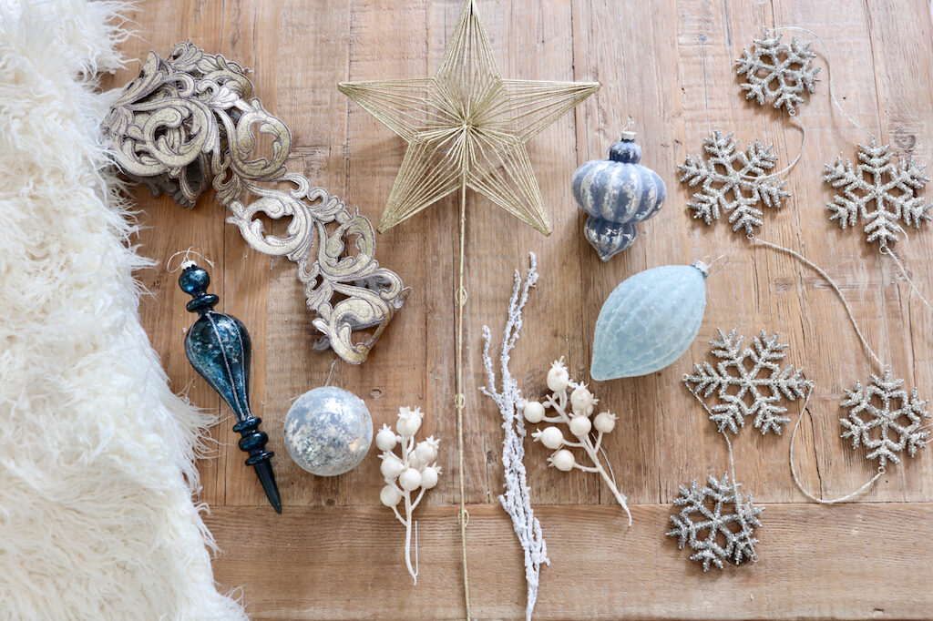 blue and white ornaments, white tree picks, victorian cutout ribbon, snowflake garland, and white fur tree skirt