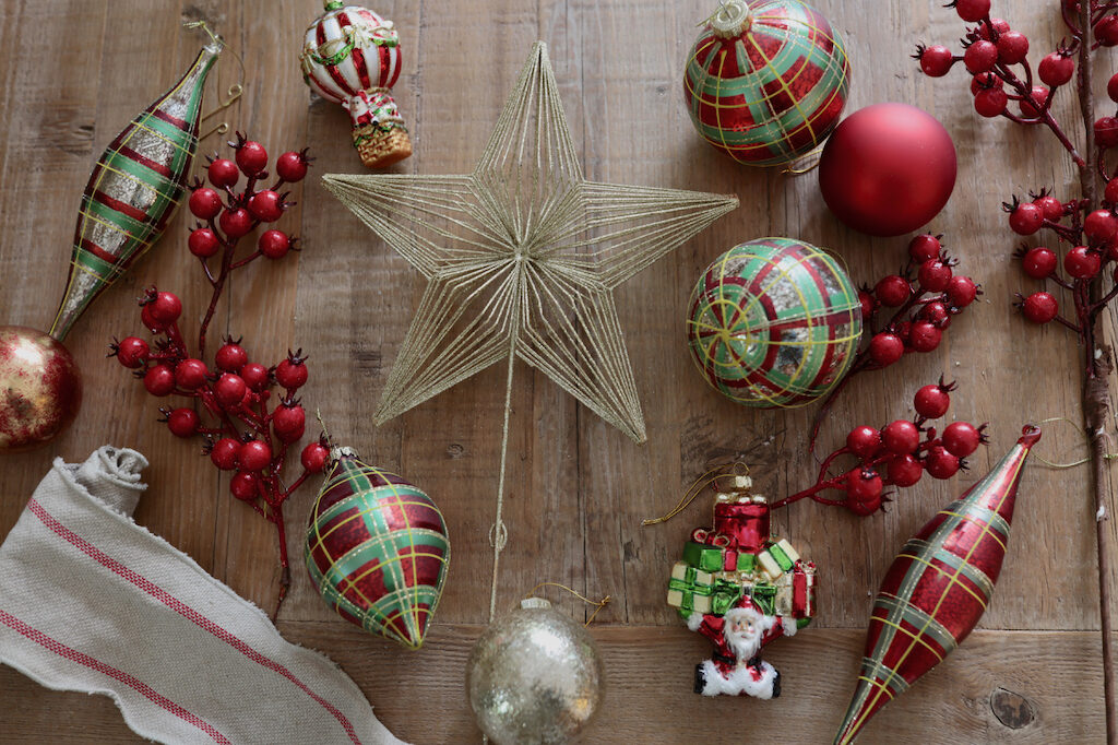 plaid christmas balls and finials, berry tree picks, brown ribbon, and christmas-themed ornaments
