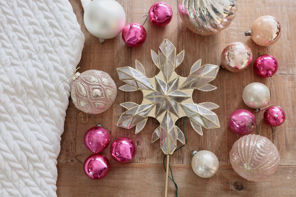 pink and blush christmas balls, snowflake tree topper, white tree skirt