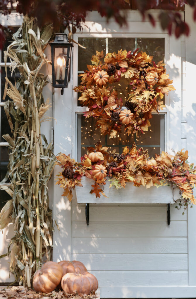 Fall wreath and garland display on window