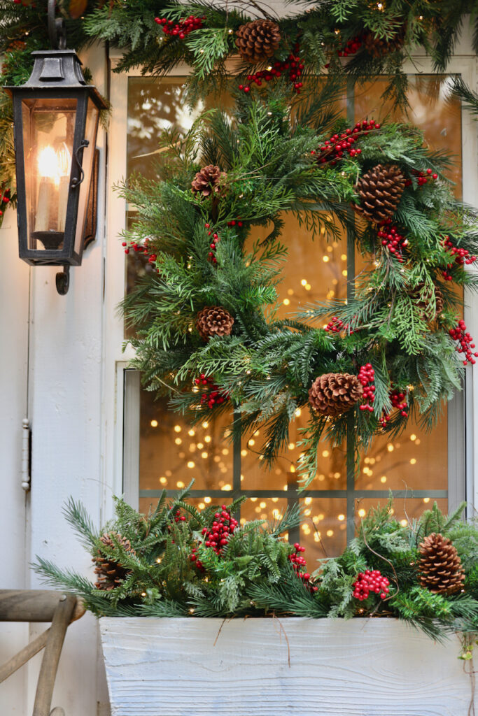 Window decorated with wreath and garlands