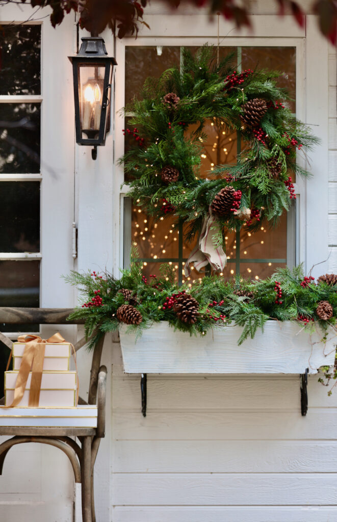 outdoor christmas wreath and garland on window